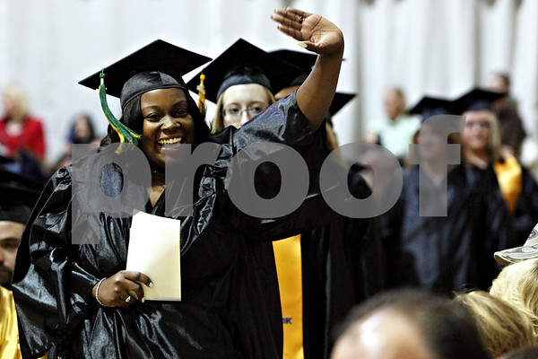Rob Winner – rwinner@daily-chronicle.com<br /> <br /> Ashley Sellars waves to friends and family while heading to the stage to receive her diploma during the Kishwaukee College commencement ceremony on Saturday May 15, 2010 in Malta, Ill. Ellison finished with an associate of arts degree.