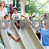 Rob Winner – rwinner@daily-chronicle.com<br /> <br /> Elle Rhode (left), 2, and her cousin Jake Gilmore, 3, go down one of the slides together at Chamberlain Park in Genoa, Ill. on the morning of Tuesday July 27, 2010. <br /> <br /> <br /> *** You can also add this if needed***<br /> <br /> Natalie Rhode (top), of Belvidere and mother of Elle, and her sister Jennifer Gilmore (right), of St. Charles and mother of Jake, meet about once a month at Chamberlain Park.