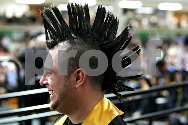 Rob Winner – rwinner@daily-chronicle.com<br /> <br /> Jared Brammer, of DeKalb, makes his way to the stage to receive his diploma during the Kishwaukee College commencement ceremony on Saturday May 15, 2010 in Malta, Ill. Due to his mohawk haircut, Brammer could not wear his cap.