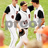 Rob Winner – rwinner@daily-chronicle.com<br /> <br /> DeKalb pitcher Ben Dallesasse heads to the dugout after the top of the first inning during the IHSA Class 3A championship in Joliet, Ill. on Saturday June 12, 2010.
