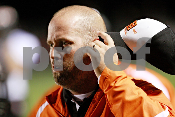 Beck Diefenbach – bdiefenbach@daily-chronicle.com<br /> <br /> DeKalb's head coach Marty Sanders  watches from the sidelines during the first quarter of the game at Kaneland High School in Maple Park, Ill., on Friday Oct. 1, 2010.