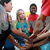 Beck Diefenbach – bdiefenbach@daily-chronicle.com<br /> <br /> West Elementary student Kaitlyn Berntsen (center) and Northern Illinois track team member Rhonda Lee (right) cheer together after running laps as part of Girls on the Run at West Elementary School in Sycamore, Ill., on Tuesday Oct. 5, 2010. Two members of the NIU's women's track team come to each of the workouts.