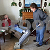 Rob Winner – rwinner@daily-chronicle.com<br /> Margie Gommel runs the vacuum cleaner as her father, Louis Meinert, 86, sits in his reclining chair at his home in DeKalb, Ill. on Saturday February 6, 2010