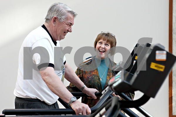 "Rob Winner – rwinner@daily-chronicle.com<br /> Emerson Wells (left), of DeKalb, works out on a treadmill machine, while having a conversation with registered nurse Faye Allen during the cardiac rehabilitation program at Kishwaukee Community Hospital in DeKalb, Ill. on Thursday February 11, 2010. ""They take good care of me,"" said Wells who began the program last July after having heart surgery in May of 2009."
