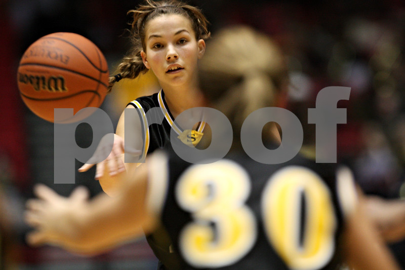 Beck Diefenbach  I  bdiefenbach@daily-chronicle.com<br /> <br /> Sycamore guard Sara Cervenka (24) passes the ball to guard Anna Buzzard (30) during the second quarter of the game against DeKalb High School at the Northern Illinois University Convocation Center in DeKalb, Ill., on Friday Jan. 30, 2009.
