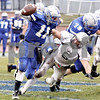 Wendy Kemp - For The Chronicle<br /> <br /> Kaneland's Tyler Callaghan (6) gets a hold of Vernon Hills quarterback Chris Argianas during Saturday's playoff game at Vernon Hills High School.