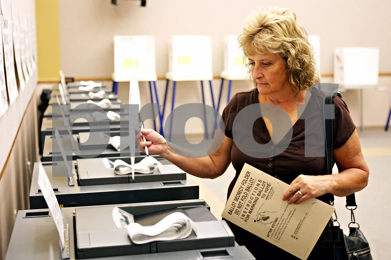 Rob Winner – rwinner@daily-chronicle.com<br /> <br /> Hinckley resident Mary Smith casts her ballot during early voting at the DeKalb County Legislative Center in Sycamore, Ill. on Tuesday October 12, 2010.
