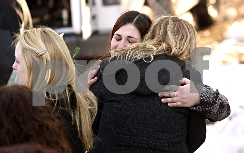 Beck Diefenbach – bdiefenbach@daily-chronicle.com<br /> <br /> Mourners embraces during the wreath laying at the memorial on NIU's campus in DeKalb, Ill., on Sunday Feb. 14, 2010.