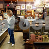 Rob Winner – rwinner@daily-chronicle.com<br /> <br /> Donna Lampkins, of Sycamore, browses over the items at Sycamore Antiques on Friday April 23, 2010 in Sycamore, Ill. Sycamore Antiques is a new business that has recently joined the Sycamore Chamber of Commerce.