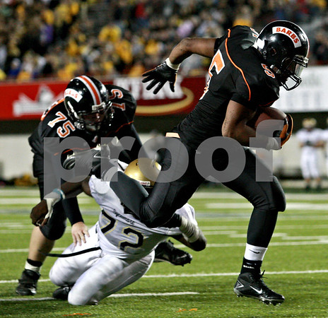 Beck Diefenbach – bdiefenbach@daily-chronicle.com<br /> <br /> DeKalb's Spencer Blank-Jones rushes for a tochdown during the fourth quarter of the Castle Challenge game between DeKalb and Sycamore High Schools at Huskie Stadium on the campus of Northern Illinois University in DeKalb, Ill., on Friday Sept. 10 2010.