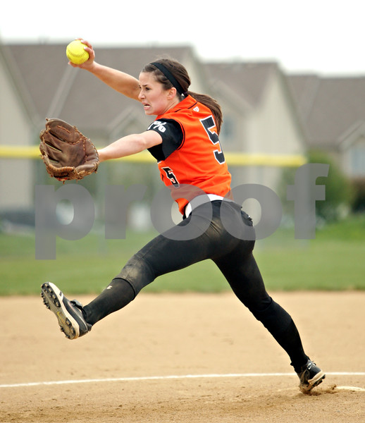 Beck Diefenbach  -  bdiefenbach@daily-chronicle.com<br /> <br /> DeKalb pitcher Tia Lexa (5) winds up during the first inning of the game against Sycamore at Sycamore High School in Sycamore, Ill., on Monday May 10, 2010.