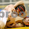 Rob Winner – rwinner@daily-chronicle.com<br /> Zack Spiewak (top), of Sycamore, holds down Ronnie Sribniak, of Genoa Kingston during their 130-pound semifinal match at the Sycamore Wrestling Invitational in Sycamore, Ill. on Saturday January 9, 2010.