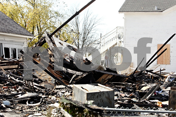 Rob Winner – rwinner@daily-chronicle.com<br /> <br /> Attorney James Groat looks at the damage of his law office after a van struck a gas meter located on the property in Sandwich, Ill. on Wednesday October 20, 2010.