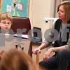 Kyle Bursaw – kbursaw@daily-chronicle.com<br /> <br /> Zach Korper reads one of the short books he's written, titled 'Mom, you embarass me!' to the after school writing club, taught by Amy Gehant, right, at North Elementary in Sycamore, Ill. on Nov. 18, 2010. One of the books Korper wrote is being made into an episode of Green Screen Adventures.