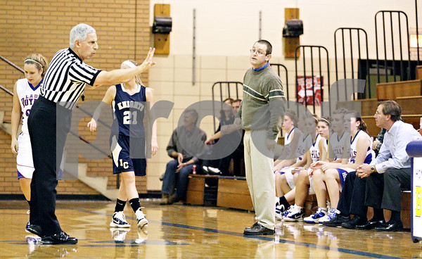 Rob Winner – rwinner@daily-chronicle.com<br /> <br /> Hinckley-Big Rock coach Greg Burks looks at the referee after a foul was called on his team during the second quarter in Somonauk, Ill. on Monday November 15, 2010.