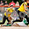 Rob Winner – rwinner@daily-chronicle.com<br /> <br /> While backing up a play, Sycamore infielder Samantha Navarro (left) controls a ball as Geneseo's Kassi Anderson steals second in the third inning of the IHSA Class 3A DeKalb Sectional championship game on Saturday June 5, 2010 in Dekalb, Ill. Sycamore lost to Geneseo, 4-1.