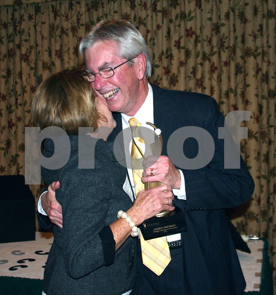 2010 Athen Award recipient Sharon Rhoades hugs event co-sponsor Mike Mooney Thursday as she receives her trophy.<br /> <br /> By NICOLE WESKERNA nweskerna@daily-chronicle.com
