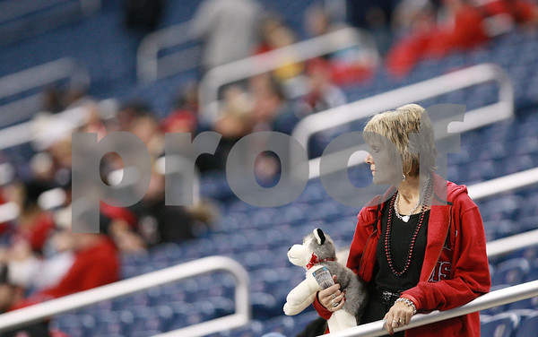 Kyle Bursaw – kbursaw@daily-chronicle.com<br /> <br /> An NIU fan watches the players warm up about an hour before the MAC Championship game at Ford Field in Detroit, Mich. on Friday, Dec. 3, 2010