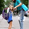 Rob Winner – rwinner@daily-chronicle.com<br /> <br /> Six-year-old Emma Johnson is helped by her mother Kathy Johnson before the start of the first day of school at Hiawatha Elementary School in Kirkland, Ill. on Tuesday August 17, 2010.