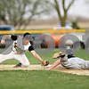 Beck Diefenbach  -  bdiefenbach@daily-chronicle.com<br /> <br /> Sycamore's Zack Spiewak (2, left) isn't able to make the out as DeKalb's Ben Dallesasse (15) slides safe into second base during the top of the seventh inning of the game at Sycamore Park in Sycamore, Ill., on Tuesday April 6, 2010.