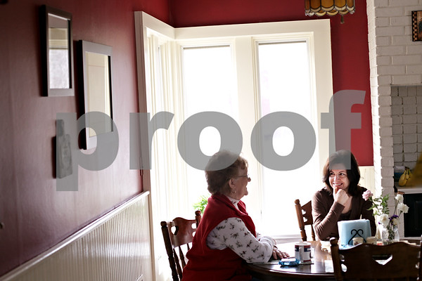 Beck Diefenbach - bdiefenbach@daily-chronicle.com<br /> <br /> Elka Marinova (far right), of Bloomingdale, Ill., and Sharon Brandt, of Wausau, Wisc., talk over breakfast at the Pay-It Forward House in Sycamore, Ill., on Tuesday March 9, 2010. The Pay It Forward House provides Marinova and Brandt with inexpensive short term accommodations as both have family members who are patients in DeKalb County.