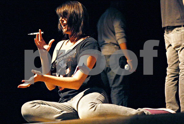 """Rob Winner – rwinner@daily-chronicle.com<br /> <br /> Layla Simone, of Batavia, acts out a scene involving drug use during a musical production called """"Stand Up!"""" at Sycamore High School on Wednesday afternoon."""