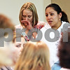 Beck Diefenbach  -  bdiefenbach@daily-chronicle.com<br /> <br /> School district bilingual program coordinator Amy Cook (left) chokes up before translating for Catalina Galindo, of DeKalb, who spoke against reducing spanish education as part of budget reduction during the public comments portion of the DeKalb School District 428 board meeting at the Education Center in DeKalb, Ill., on Tuesday March 16, 2010.