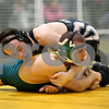 Rob Winner – rwinner@daily-chronicle.com<br /> Kyle Culton (top), of Sycamore, tries to control Mark Mohler, of Crystal Lake South, during their 140-pound semifinal match at the Sycamore Wrestling Invitational in Sycamore, Ill. on Saturday January 9, 2010.
