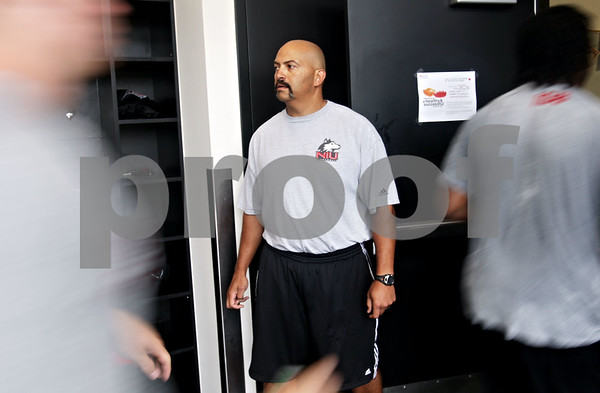 Beck Diefenbach - bdiefenbach@daily-chronicle.com<br /> <br /> Strength and conditioning coach Eric Klein waits for the football defensive players to enter the weight room at the Yordon Center on the Northern Illinois University Campus in DeKalb, Ill., on Tuesday Aug. 10, 2010.