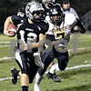 Wendy Kemp - For The Kane County Chronicle<br /> Kaneland quarterback Joe Camiliere runs for a touchdown during Friday's playoff game against King College Prep.<br /> Maple Park 10/29/10