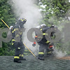 Rob Winner – rwinner@daily-chronicle.com<br /> <br /> DeKalb firefighters respond to a fire call on the 300 block of Knollwood Drive in DeKalb, Ill. on Saturday June 5, 2010.