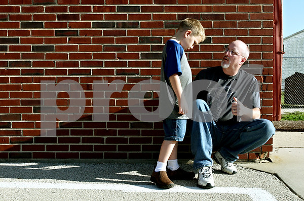 Rob Winner – rwinner@daily-chronicle.com<br /> <br /> Being a little nervous about the first day of school, six-year-old Peyton Manis talks with his father Ben Manis at Malta Elementary School in Malta, Ill. on Monday August 23, 2010. This was the last first day of school for Malta Elementary School which will be closed at the end of the academic year.