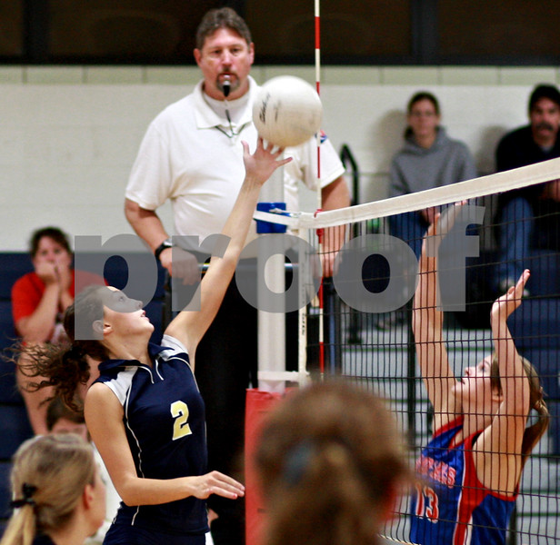Beck Diefenbach – bdiefenbach@daily-chronicle.com<br /> <br /> Hiawatha's Dani Clark (2) tips the ball over the net during the second game of a match against Hinckley-Big Rock at Hiawatha High School in Kirkland, Ill., on Thursday  Sept. 16, 2010. H-BR defeated Hiawatha 2 to 0.