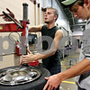 Rob Winner – rwinner@daily-chronicle.com<br /> <br /> Devin Brown (left), of Sandwich, and Matt Leedy, of Yorkville, replace a tire in the auto mechanics room at the Indian Valley Vocational Center in Sandwich, Ill. on Thursday September 16, 2010.