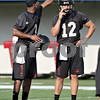 Beck Diefenbach - bdiefenbach@daily-chronicle.com<br /> <br /> Northern Illinois quarterbacks DeMarcus Grady (left) and Chandler Harnish during the first practice at Huskie Stadium in DeKalb, Ill., on Thursday Aug. 5, 2010.