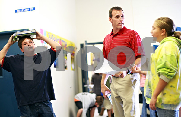 Beck Diefenbach – bdiefenbach@daily-chronicle.com<br /> <br /> To combat bullying outside the classroom, teachers like seventh grade math teacher Brant Boyer stand in the hallway during passing periods to to be visible for children as they change classes at Clinton Rosette Middle School in DeKalb, Ill., on Wednesday Sept. 15, 2010.