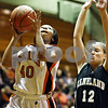 Rob Winner – rwinner@daily-chronicle.com<br /> <br /> DeKalb's Courtney Patrick (40) is fouled by Kaneland guard Emily Heimerdinger during the second quarter in DeKalb on Tuesday.