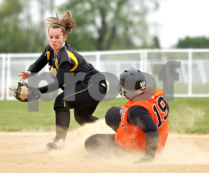 Beck Diefenbach  -  bdiefenbach@daily-chronicle.com<br /> <br /> Sycamore's Becca Schroeder (3, left) spins around for the tag as DeKalb's Vicki Vonbergen (19) slides safe into second base during the third inning of the game at Sycamore High School in Sycamore, Ill., on Monday May 10, 2010.