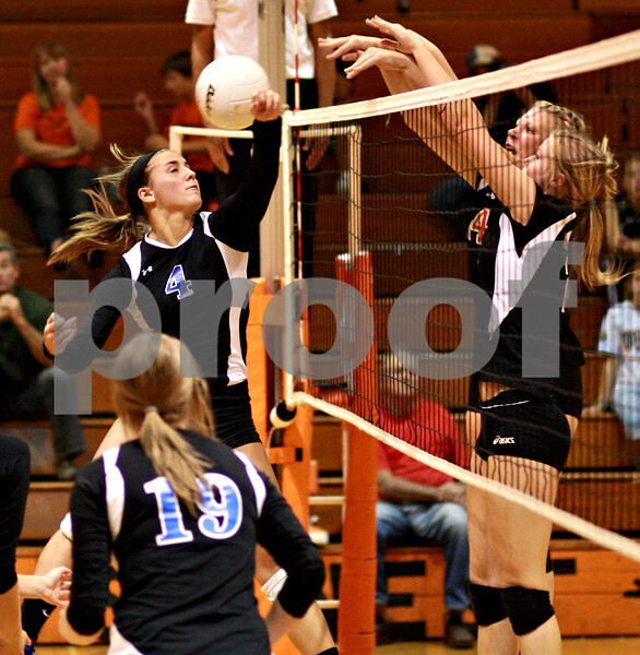 Beck Diefenbach  -  bdiefenbach@daily-chronicle.com<br /> <br /> Geneva's Brooke Binette (4, left) attempts to return a block by DeKalb's Mackenzie Johnson (back) and Baleigh Euhus during the second game of a match at DeKalb High School in DeKalb, Ill., on Thursday Sept. 9, 2010. Geneva defeated DeKalb 2 to 0.
