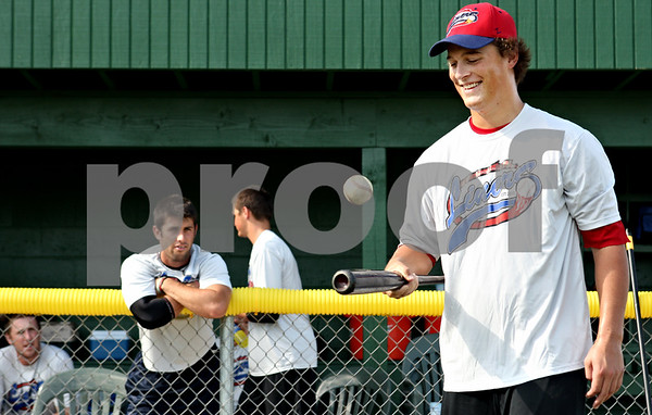 Rob Winner – rwinner@daily-chronicle.com<br /> <br /> Cam Verbeke, of the DeKalb County Liners, bounces a ball off a bat after batting practice before a game on Friday July 9, 2010 in Sycamore, Ill.