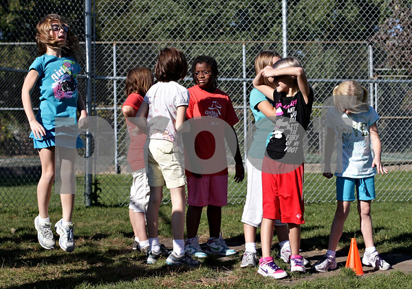 Beck Diefenbach – bdiefenbach@daily-chronicle.com<br /> <br /> Girls warm up before running laps as part of Girls on the Run at West Elementary School in Sycamore, Ill., on Tuesday Oct. 5, 2010.