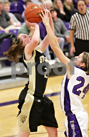 Beck Diefenbach  -  bdiefenbach@daily-chronicle.com<br /> <br /> Sycamore's Kate Binder's (21, left) shot is blocked by Hampshire Cassie Dumoulin (24) during the fourth quarter of the IHSA Class 3A Regional game at Rochelle Township High School in Rochelle, Ill., on Wednesday Feb. 17, 2010