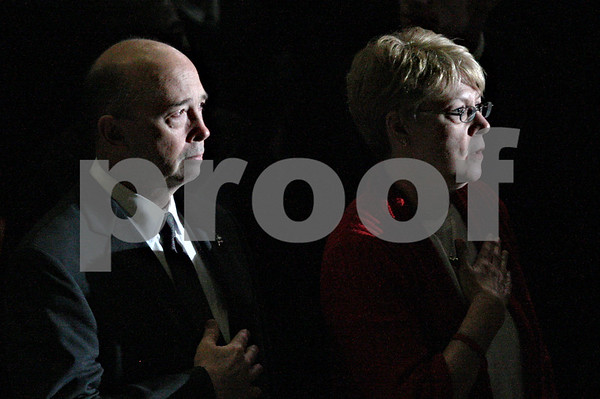 Rob Winner – rwinner@daily-chronicle.com<br /> <br /> Gary Parmenter and Linda Greer, parents of Daniel Parmenter, stand for the national anthem at the start of Saturday's graduation ceremony at NIU in DeKalb, Ill.