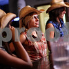 Beck Diefenbach – bdiefenbach@daily-chronicle.com<br /> <br /> Amy Sakiewicz (center) waits with other waitresses for orders at Daisy's Sports Bar and Grill in DeKalb, Ill., on Thursday Sept. 10, 2010.