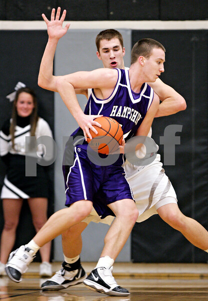 Beck Diefenbach - bdiefenbach@daily-chronicle.com<br /> <br /> Hampshire's Tyler Watzlawick (44, front) tries to dribble around Kaneland's Dave Dudzinski during the first quarter of the IHSA Class 3A semifinal regional game at Kaneland High School in Maple Park, Ill., on Wednesday March 3, 2010.