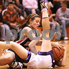 Kyle Bursaw – kbursaw@daily-chronicle.com<br /> <br /> DeKalb's Kelli Gerace and a Hampshire defender fall to the ground while struggling for posession. Hampshire defeated DeKalb 46-38 at DeKalb High School on Saturday, Nov. 27, 2010 during the Turkey Toss-Up tournament.
