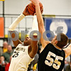 Rob Winner – rwinner@daily-chronicle.com<br /> Sycamore's Sam Ford looks to the basket, but Kaneland's Dave Dudzinski is able to block Ford's shot in the second quarter.