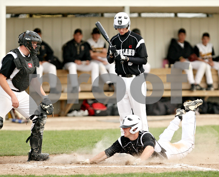 Beck Diefenbach  -  bdiefenbach@daily-chronicle.com<br /> <br /> Kaneland's Tyler Callaghan (23) steals home during Ty Hamer's (5, top) at bat in the third inning of the game against Sycamore at Kishwuakee College in Malta, Ill., on Friday May 14, 2010. Kaneland defeated Sycamore 5 to 2.