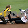 Rob Winner – rwinner@daily-chronicle.com<br /> <br /> DeKalb's Kelli Gerace (right) slides safely under the tag of Sycamore's Anna Buzzard while stealing second base in the first inning.