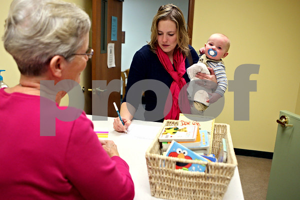 Rob Winner – rwinner@daily-chronicle.com<br /> Kori Mauch, of Sycamore, drops off her 7-month-old son Nathan at the infant nursery before joining other mothers for Moms Connected at Evangelical Church of Sycamore-DeKalb in DeKalb, Ill. on Thursday January 14, 2010.